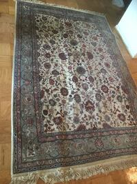 Persian Rug 6ft by 9 1/2 feet. Looks lumpy because other rugs are underneath it   Arlington, 22202