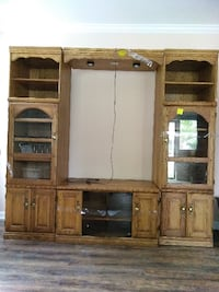 brown wooden TV hutch with flat screen television Baton Rouge
