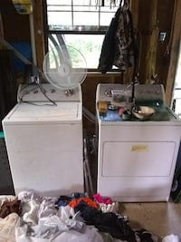two white clothes washer and dryer set