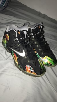 black-and-green Nike basketball shoes