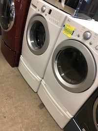 LG front load washer and dryer set with pedestal  Baltimore, 21223