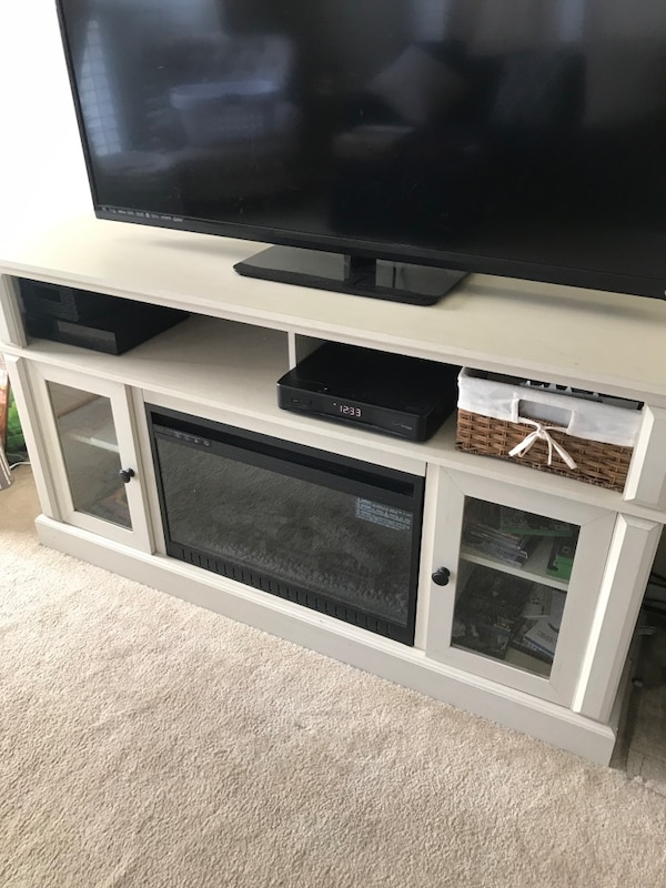 TV STAND WITH ELECTRIC FIREPLACE INSTALLED b0305f84-a8a1-4c0d-b470-54852d4b5651