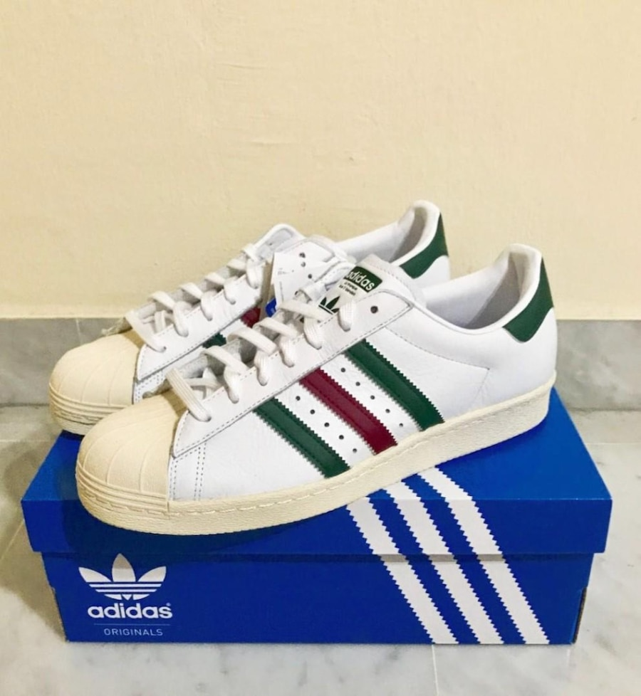 Brand New Adidas Originals Superstar 80s White Sneakers with red and green stripes. Size 11