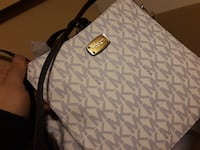 white Michael Kors monogrammed leather tote bag