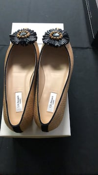 pair of brown leather flats Calgary, T3L 0A6