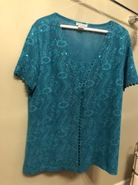 Blouse   Color Blue  In an excellent condition worn only once Size PXL bought it from USA Asking $8.00 Montréal