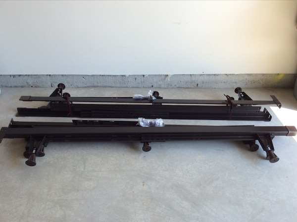 2 black metal adjustable bed frames queen/king