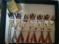 twelve stainless steel forks with box