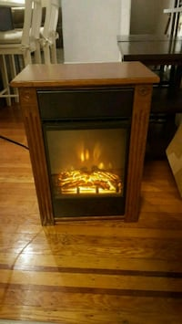 brown and black electric fireplace Baltimore, 21224