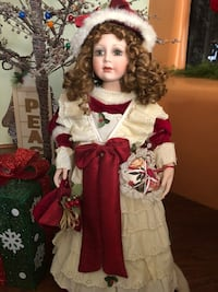 Christmas Girl doll wearing white and red dress