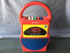 red and yellow Sony Cassette player