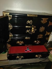 black and red wooden dresser