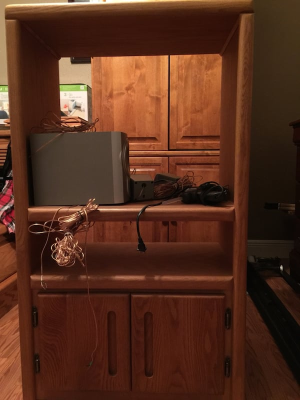 Brown wooden cabinet with shelf 0