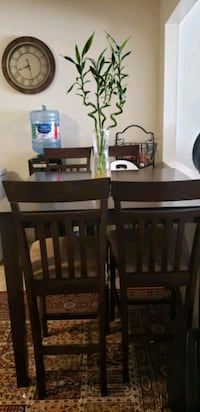 A dining table with four chairs Burnaby