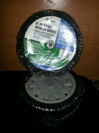 white and black plastic mower wheel 1363 mi