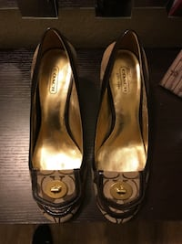 pair of brown-and-gold Coach pumps