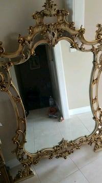brown wooden framed mirror with mirror 782 km