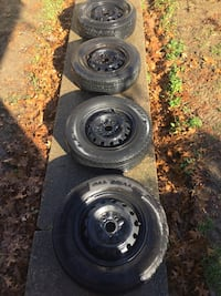 Set of four 5x114.3 Steel rims with tires. Three of the tires are pretty good. One is at the tread marker but can still be used. Fit a lot of sedans and suvs. Henderson, 42420
