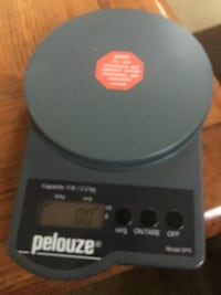 Black Pelouze digital weighing scale