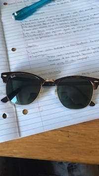 black framed Ray-Ban sunglasses Laval, H7G 2L5