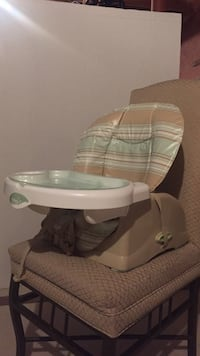 white, beige and green high chair
