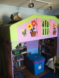 pink and green wooden playhouse