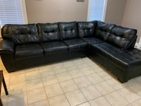 Black leather sofa and chaise