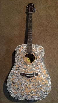 Black and brown acoustic guitar sparkling
