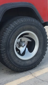 Jeep Wrangler rims with tires size 33 x 12.50 R 15
