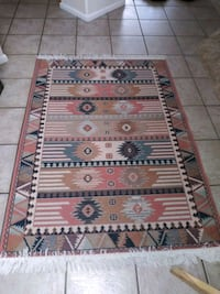 5' x 3 1/2' NM style area rug great condition