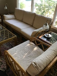 brown wooden framed white padded sofa set