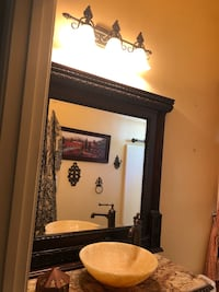 Custom granite and onyx vessel vanity with matching mirror  Bakersfield, 93306