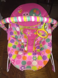 baby's pink and multicolored bouncer 51 km