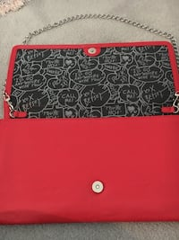 Betsey Johnson red clutch bag with removable chain strap. New without Tags, never been used. Very cool lining.