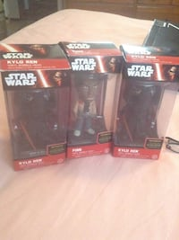 three Star Wars Kylo Ren and Finn bobbleheads with packs