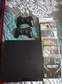 Sony PS3 slim console with controller and game cas 2411 mi