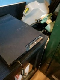 Ps3 with mic controller and 7 games  Cambridge, N3H 2K6