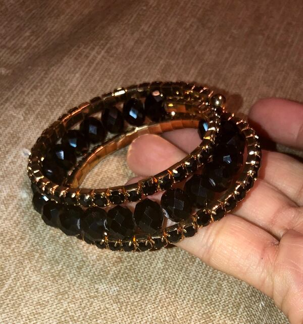 Gold and black bracelet  9fe3a1fa-a188-455f-8958-51d9256c46b5