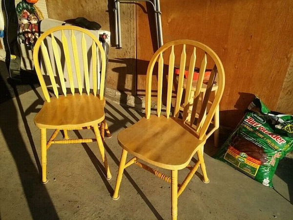 four brown wooden windsor chairs