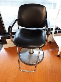 black leather padded rolling chair North Vancouver, V7M 1W4