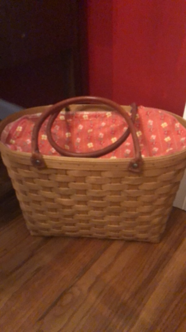 brown and red leather tote bag