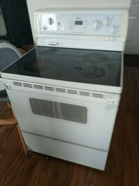 white and black induction range oven Calgary, T3G 5L2
