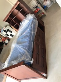 Twin size Captain bed with Mattress included. This item has a matching dresser with mirror and night stand. Located in Yukon. Garage Pick-up only. This item is $200. Other items mentioned sold separately .