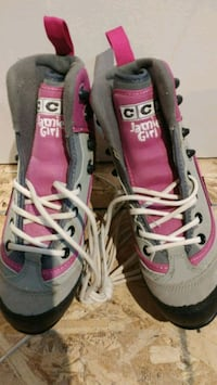 pair of pink-and-gray CCM Jamie Girl skates Senneville, H9X 1A4
