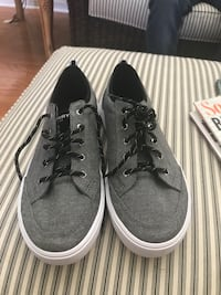 Gray-and-white sperry low-top sneakers. new still has sticker on bottom never worn size 6.5 Belton, 29627