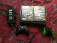 Xbox 360 console with two controllers and game cas Arlington, 76010