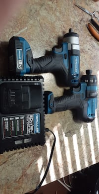 2  impact  drills  one0 3/8 ; 1/4in  with Battery,charger,impact bits  both  are  12  volts