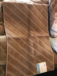 Brown rugs new with tag