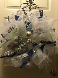 white and blue ribbon wreath