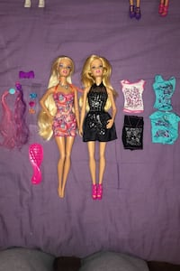 Two Barbie dolls with accessories